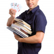 Student holding books and poker cards — Stock Photo