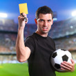 Referee with yellow card — Stock Photo