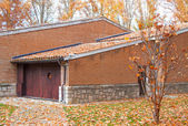 House with fallen leaves — Stock Photo