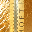 Moet champagne on golden background — Stock Photo #36971713