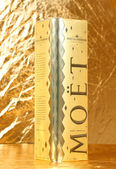 Moet champagne on golden background — Stock Photo