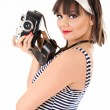Beautiful girl holding old camera — Stock Photo