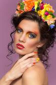 Beautiful brunette wearing flower headband — Stock Photo