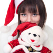 Girl with christmas polar bear — Stock Photo