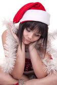 Sad girl in christmas hat — Stock Photo