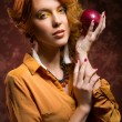 Autumn girl with apple — Stock fotografie