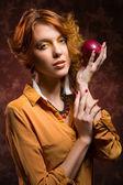 Autumn girl with apple — Stock Photo