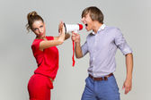 Young man screaming at girlfriend — Stockfoto