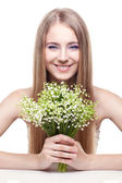 Woman with lily of the valley — Stock Photo