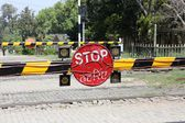 Barrier at a railroad crossing — Stock Photo