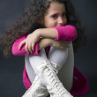 Pretty little girl sitting on the floor in white boots — Stock Photo #41786839