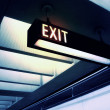 Exit sign in airport — Stock Photo