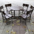 Stock Photo: Table and chairs in city
