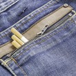 Snuff in jeans — Stock Photo