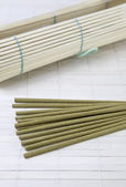 Incense sticks and bamboo — Stock Photo