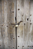 Wooden door with padlock — Stock Photo