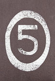 Number five painted on the ground — Stock Photo