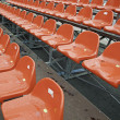 Rows of red wet bleachers — Stock Photo #27927593