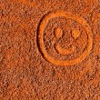 Emoticon in the sand — Stock Photo