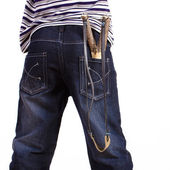 Jeans with a slingshot in his pocket — Stock Photo