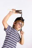 Boy shoots a slingshot — Stock Photo