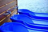 Blue wheelbarrows — Stock Photo