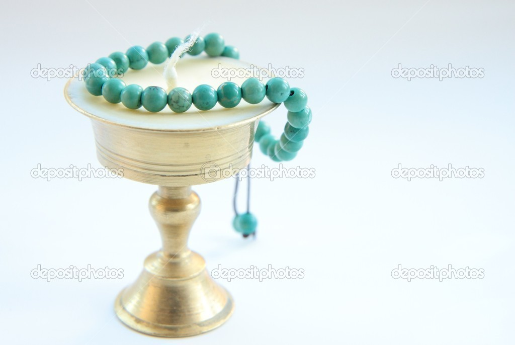 Tibetan candle & blue bracelet — Stock Photo #14959543