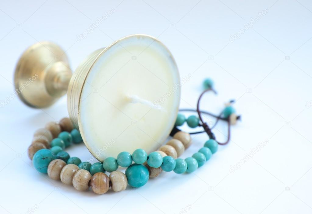 Tibetan candle with bracelet — Stock Photo #15533643
