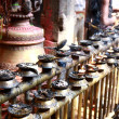 Candles & incense on a fence — Stockfoto