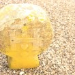 Stock Photo: Yellowish tombstone