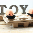 Stock Photo: Two toys with moustaches