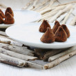 Chocolate truffles on saucers — Stock Photo #31105317