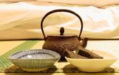 Iron teapot on tatami — Stok fotoğraf