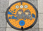 Funny manhole cover — Stock Photo