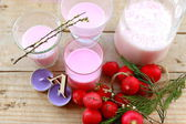 Radishes and candles — Stock Photo