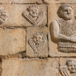 Stock Photo: Stone carving on church wall