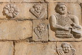 Stone carving on the church wall — Stock Photo