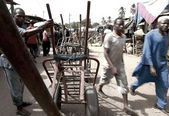 Wheel barrows in Ziguinchor market — Stock Photo