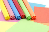 Pens on colored paper — Stock Photo