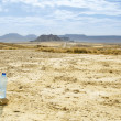 Stock Photo: Bottle of water in Desert of Bardenas Reales in Navarre