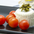 Fresh cheese with cherry tomatoes — Stock Photo