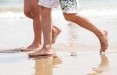 Walking on the beach — Stok fotoğraf