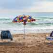 Stock Photo: Umbrelland chairs on beach