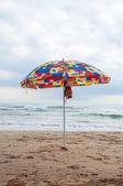 Umbrella on the beach — Stok fotoğraf