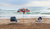 Umbrella and chairs on the beach — Stock Photo
