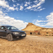 Stock Photo: Car in Desert of Bardenas Reales in Navarre