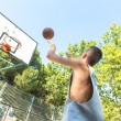 Young man playing basketball — Stock Photo #35177507