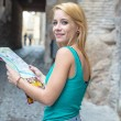 Young female tourist studying a map — Foto de Stock