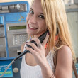 Girl in a phone booth — Stock Photo