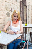 Girl with a phone mobile — Stock Photo